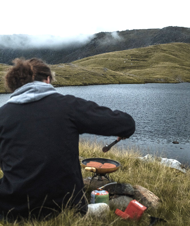 Walker enjoying food on the go in the Lake District