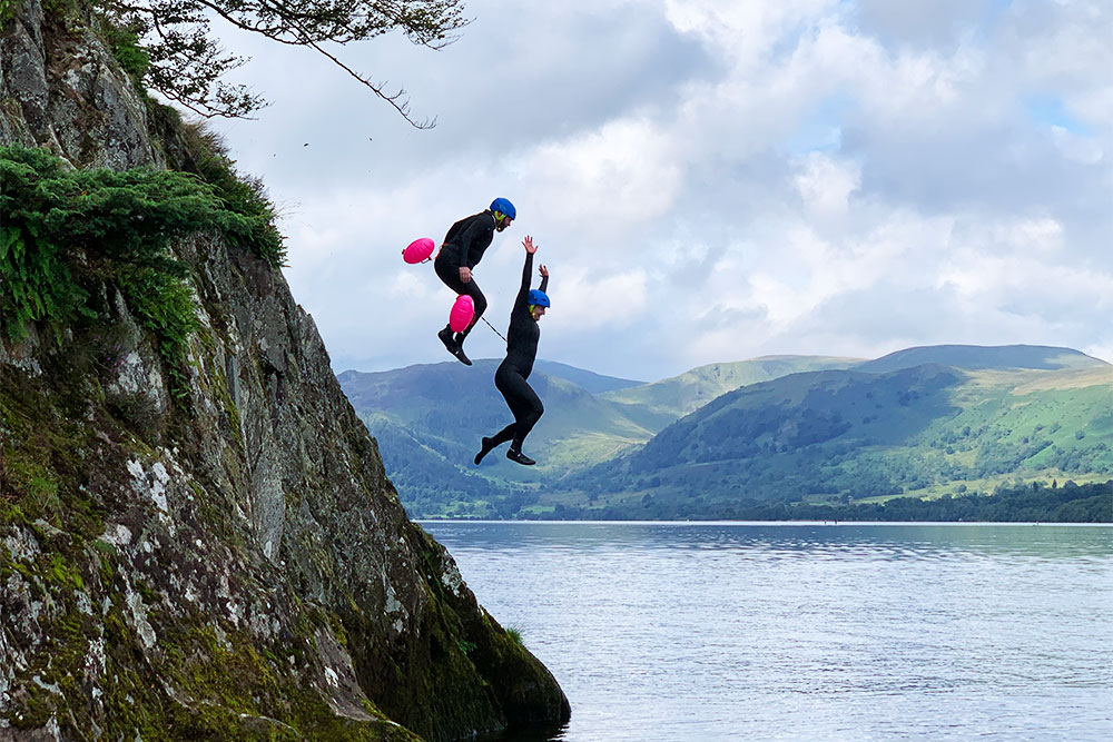 Guests jumping from Kailpot into Ullswater