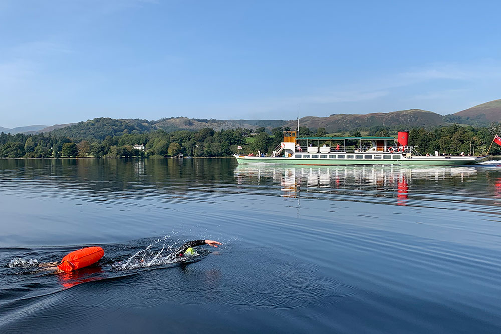 Swimming in the lake as the Ullswater Steamer travels past