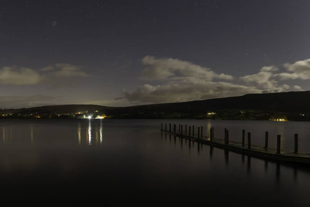 The hotel jetty and sky full of stars by Ben Bush