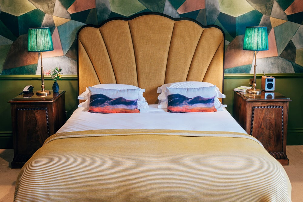 Hotel suite bedroom upholstered headboard