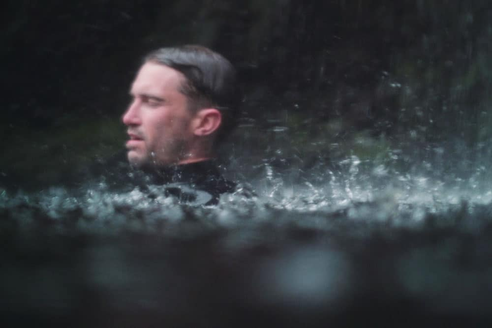 Joe Minihane cold water therapy under a waterfall in the Lake District
